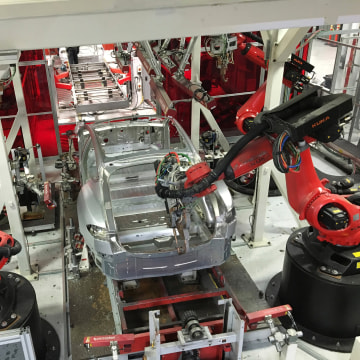 Image: Tesla vehicles are being assembled by robots at Tesla Motors Inc factory in Fremont