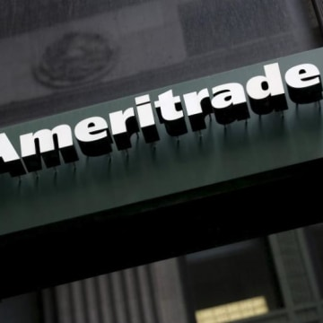 A TD Ameritrade sign is seen outside a branch in the financial district in New York