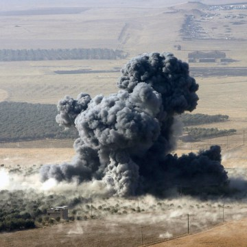 Image: Smoke rises from ISIS positions