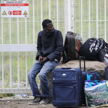 Image: Migrants Leave The Jungle Refugee Camp In Calais