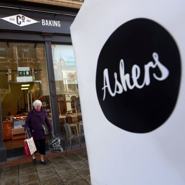 Image: A woman leaves Ashers bakery in Belfast
