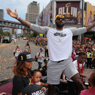 Image: Cleveland Cavaliers Lebron James celebrates with the crowd in downtown Cleveland