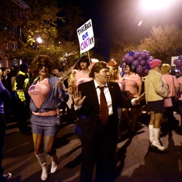 Image: Runners parade along 17th Street after the annual drag High Heel Race in Washington