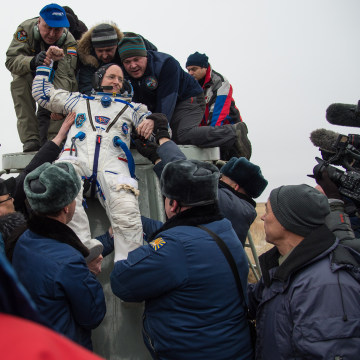 Image: Expedition 46 Commander Scott Kelly of NASA is helped out of the Soyuz TMA-18M spacecraft