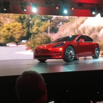 A Tesla Model 3 sedan, its first car aimed at the mass market, is displayed during its launch in Hawthorne