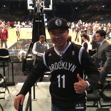 Mark Tsai, of Connecticut, and his 11-year-old son Colin attended the Brooklyn Nets' home season opener on Friday, October 28, 2016