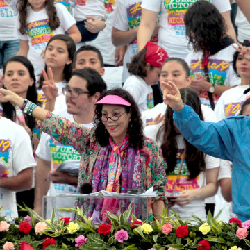 Image: Nicaragua's President Daniel Ortega and  first lady  Rosario Murillo greets supporters during celebrations to mark the 37th anniversary of the Sandinista Revolution in Managua