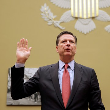 "Image: FBI Director Comey is sworn in before testifying before a House Judiciary Committee hearing on ""Oversight of the Federal Bureau of Investigation"" on Capitol Hill in Washington"