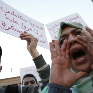 Image: A Moroccan shouts as thousands of Moroccans protest against the death of Mouhcine Fikri