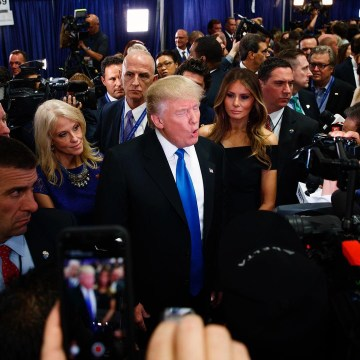 Image: Trump speaks with reporters in the spin room after the first presidential debate