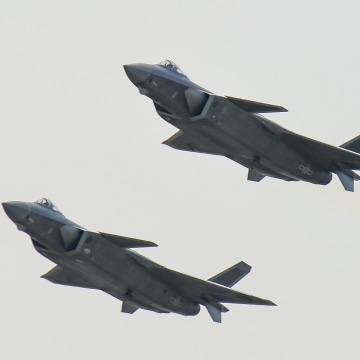 Image: J-20 stealth fighter jets fly in Zhuhai