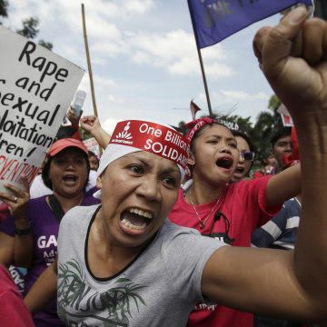 Image: A protester shouts slogans after scuffling with riot police near the U.S. Embassy during a rally Friday.
