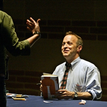 "Humorist/writer David Sedaris interacting with fan during the signing of his new book ""Dress our Fam"