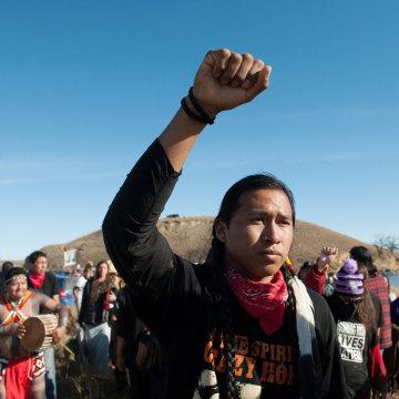 Image: People protest against the building of a pipeline on the Standing Rock Indian Reservation near Cannonball, North Dakota