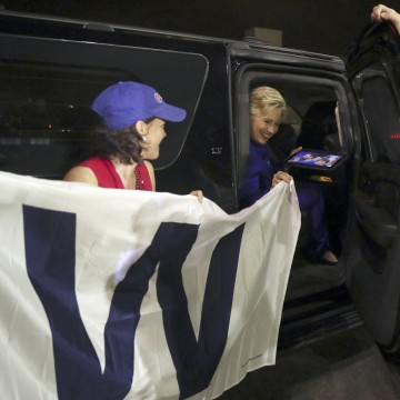 Image: Clinton holds a 'W' banner as the Chicago Cubs win the World Series