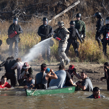 Image: Police use pepper spray against protesters trying to cross a stream near an oil pipeline construction site near Standing Rock Indian Reservation, north of Cannon Ball