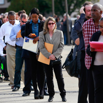 Image: People wait in line to enter the Nassau County Mega Job Fair at Nassau Veterans Memorial Coliseum in Uniondale, New York