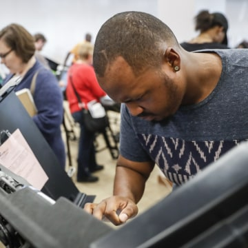 Image: Elijah Ransom of Columbus, Ohio, votes early at the Franklin County Board of Elections