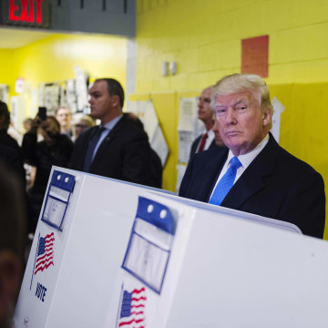 Image: Trump fills out his ballot at a polling station