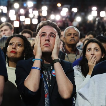 Image: People watch the election results