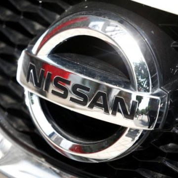 The logo of Nissan is seen on a Qashqai car at its dealership in Seoul
