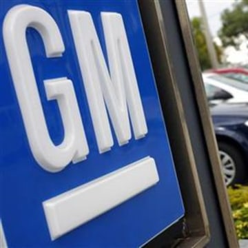 Chevrolet cars are seen in line at the parking lot of Tropical Miami General Motors dealership in Miami