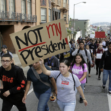 Image: High school students carry signs as they march in opposition of Donald Trump's presidential election victory in San Francisco