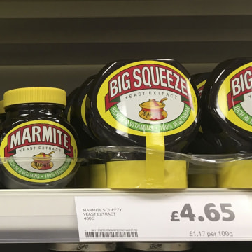 Image: Jars of Marmite are displayed for sale on a shelf at a Tesco supermarket near Manchester