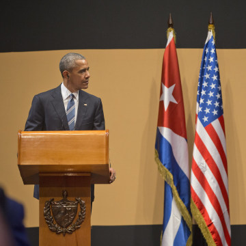 Image: President Barack Obama listens as Cuban President Raul Castro speaks