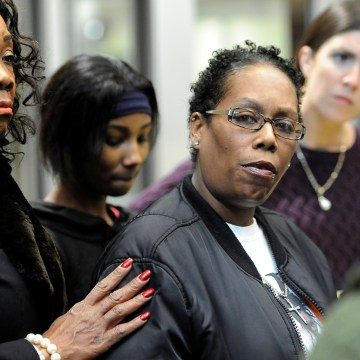 Image: Wilson, cousin of Castile talks with reporters after Minnesota police officer Yanez made his first court appearance after being charged in connection with the shooting death of black motorist Castile, at Ramsay County District Court in St. Paul