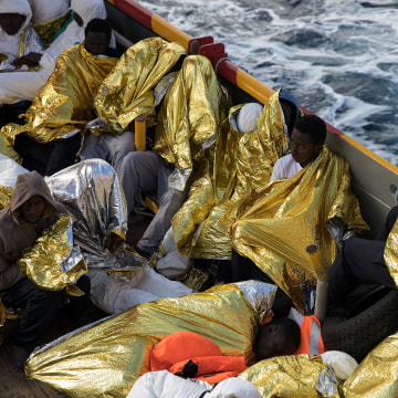 Image: Some of more than 600 people rescued off Italy