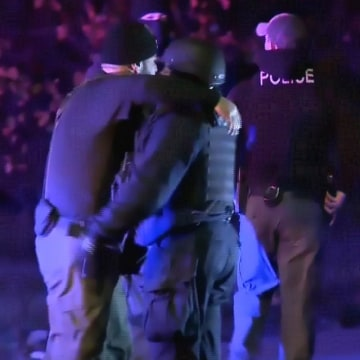 IMAGE: Police embrace after shooting