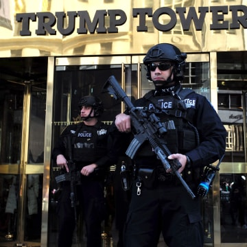 Image: New York Police Department (NYPD) officers guard the main entrance of the Trump Tower