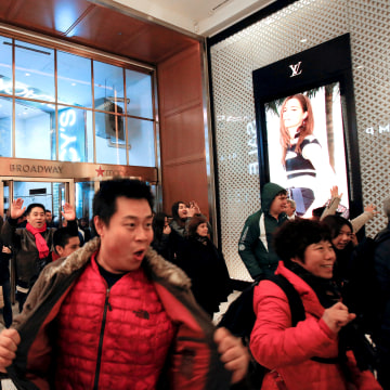Image: People enter Macy's Herald Square for early opening of the Black Friday sales in Manhattan, New York