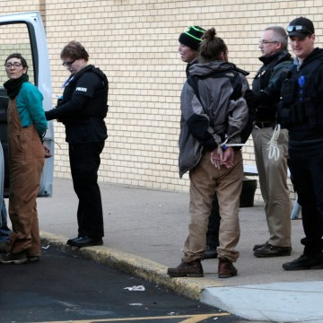 Image: A woman is taken into police custody outside an anti-Dakota Access Pipeline protest at Kirkwood Mall in Bismarck, North Dakota