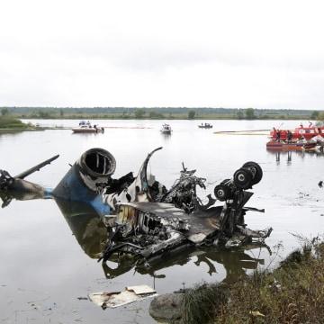 Image: Russian investigators work after 2011 plane crash
