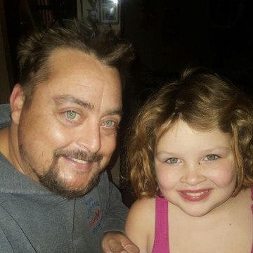 Image: Michael Reed with one of his daughters