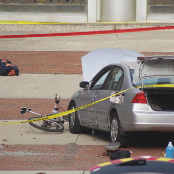 Image: A car which police say was used by an attacker to plow into a group of students is seen outside Watts Hall on Ohio State University's campus in Columbus