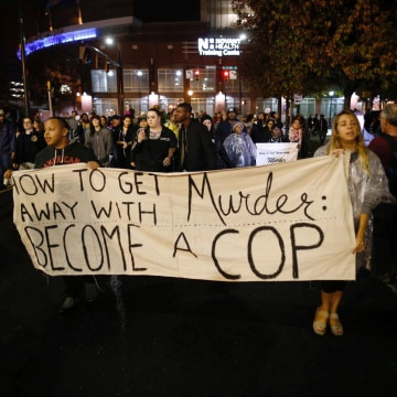 Image: Protesters march through uptown Charlotte, North Carolina November 30, 2016, following the decision of the district attorney not to press criminal charges against police in the shooting of Keith Scott.