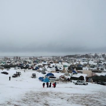 Image: Snow covers the ground at Oceti Sakowin Camp on Thursday