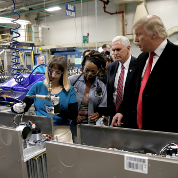 Image: U.S. President-elect Donald Trump tours a Carrier factory with Greg Hayes, CEO of United Technologies (L) in Indianapolis