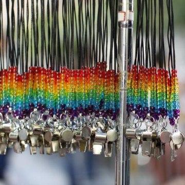 Rainbow whistles are shown hanging at the San Francisco Gay Pride Parade
