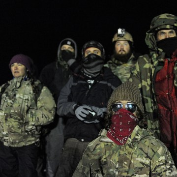 Image: Veterans have a demonstration on Backwater bridge during a protest against plans to pass the Dakota Access pipeline near the Standing Rock Indian Reservation, near Cannon Ball, North Dakota, U.S.