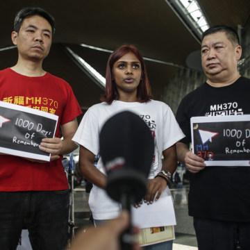 Image: MH370 relatives Grace Subathirai Nathan of Malaysia stands between and Jiang Hui (left) and Bai Shuan Fu (right) from China at Kuala Lumpur International Airport before their trip to Magadascar.