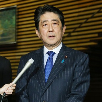 Image: Japan's prime minister Shinzo Abe announced his visit to reporters Tokyo Monday.