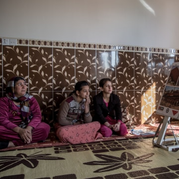 Image: Women in the village receive life-saving lessons from Mines Advisory Group (MAG), including how to distinguish between the many types of deadly explosives left behind by ISIS.