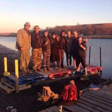 Alicia Smith with other water protectors on a pier she helped build at Standing Rock.