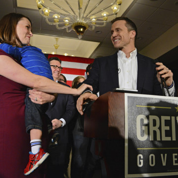 Image:Eric Greitens, Sheena and their son Joshua during his victory speech  in Chesterfield, Missouri last month.