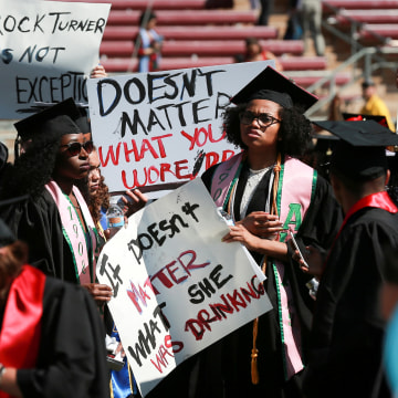 Image: Protesters hold signs to raise awareness of sexual assault at Stanford University