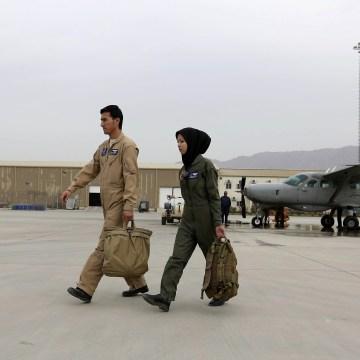 Image: Capt. Safia Ferozi, right, and her husband Capt. Mohammad Jawad Najafi, left